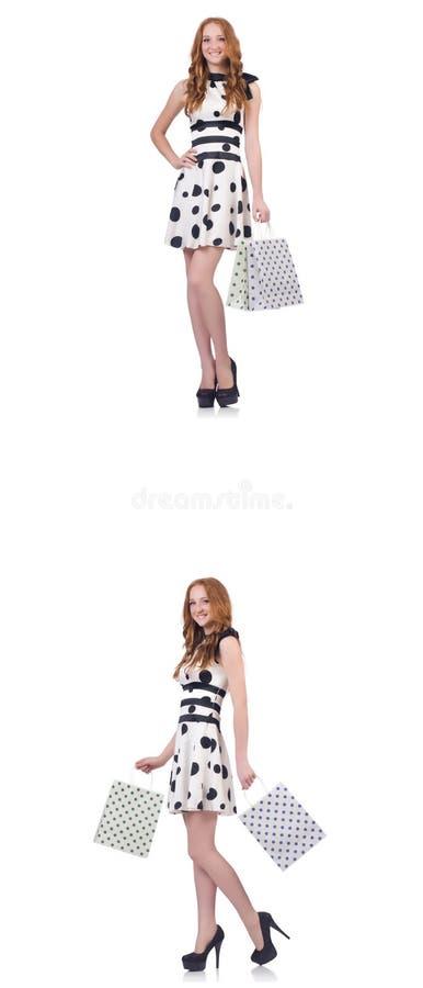 Pi?kna kobieta z torbami odizolowywa? na bielu ilustracji
