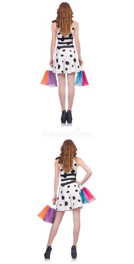 Pi?kna kobieta z torbami odizolowywa? na bielu obraz royalty free