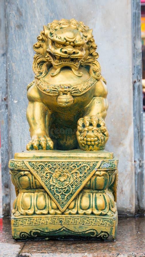 Pi Xiu or gold dargon statue in Shrine.  stock image
