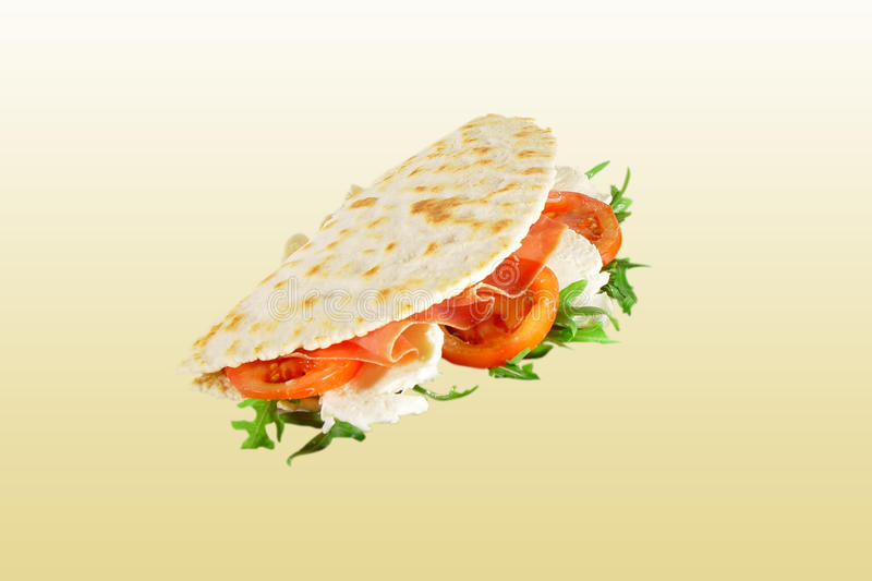 Piadina with cheese. Italian specialty - piadina with ham and cheese stock photography