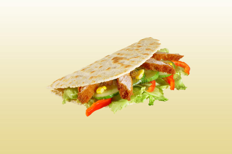 Piadina with chicken. Italian specialty - piadina with chicken royalty free stock image