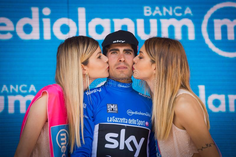 Piancavallo, Italy May 26, 2017: Mikel Landa, in blue jersey as best climber, celebrates on the podium his victory royalty free stock photo