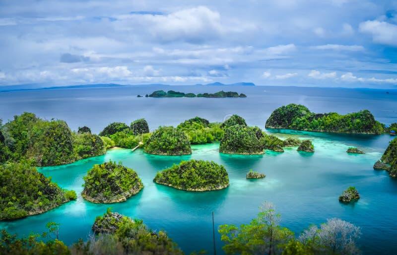Pianemo Islands, Raja Ampat, West Papua, Indonesia. Pianemo Islands, Blue Lagoon with Green Rockes, Raja Ampat, West Papua. Indonesia stock photography