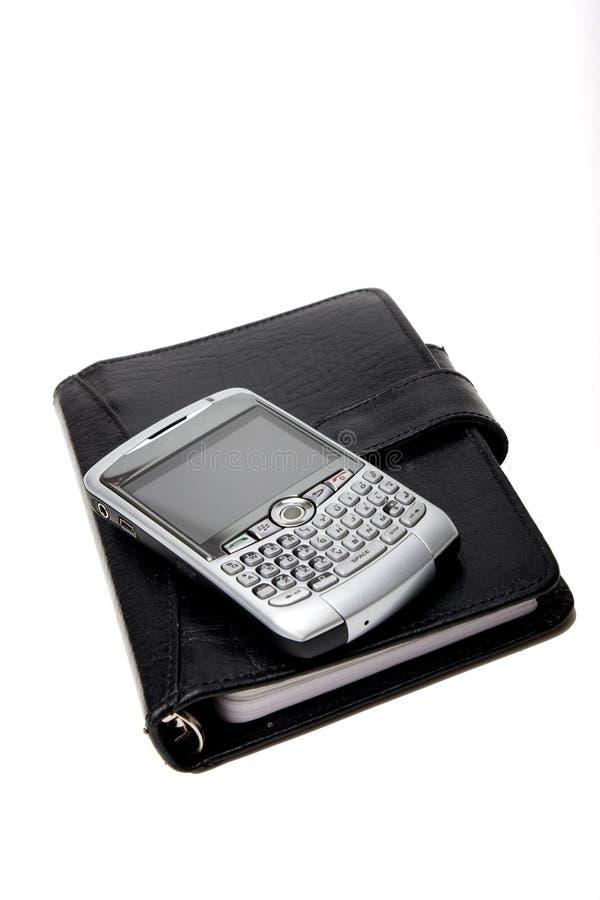Pianificatore chiuso con PDA immagini stock libere da diritti