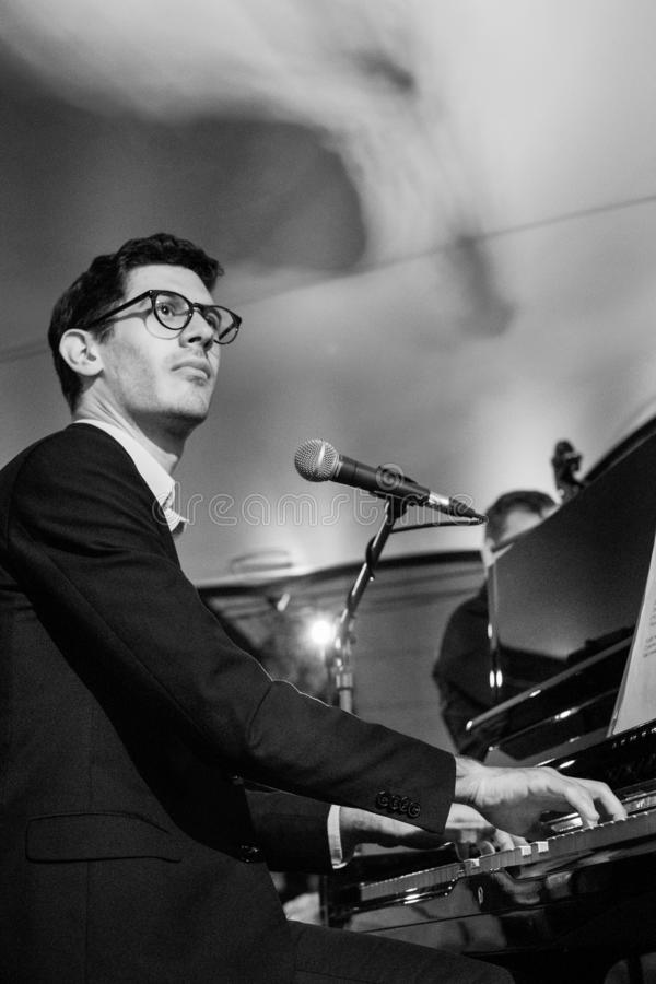 Pianist playing Klezmer at a concert at the Jewish Culture Festival, hosted annually in Kazimierz, Krakow, Poland. Musician playing at a Klezmer concert at the stock photography