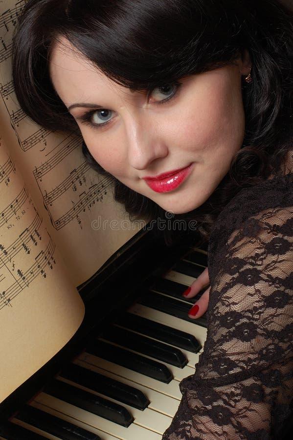 Pianista di flirt fotografia stock