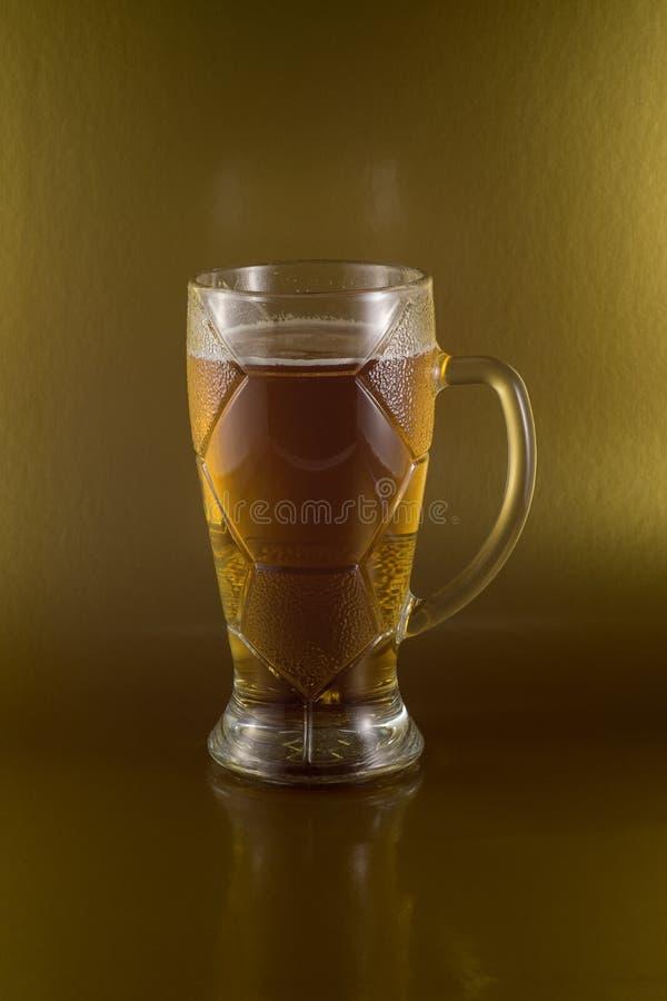 Piankowaty piwo w oryginalnym szkle fotografia royalty free