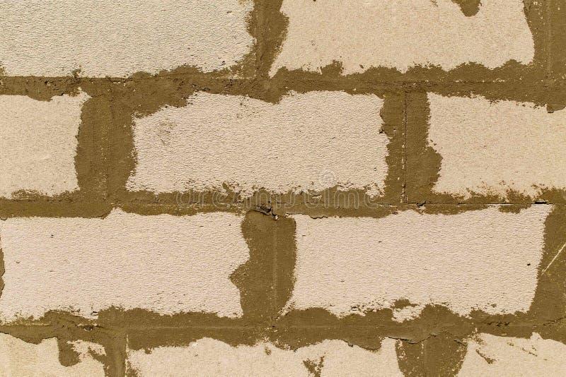 Piankowe betonowe cegły w ścianie jako abstrakcjonistyczny tło obraz royalty free
