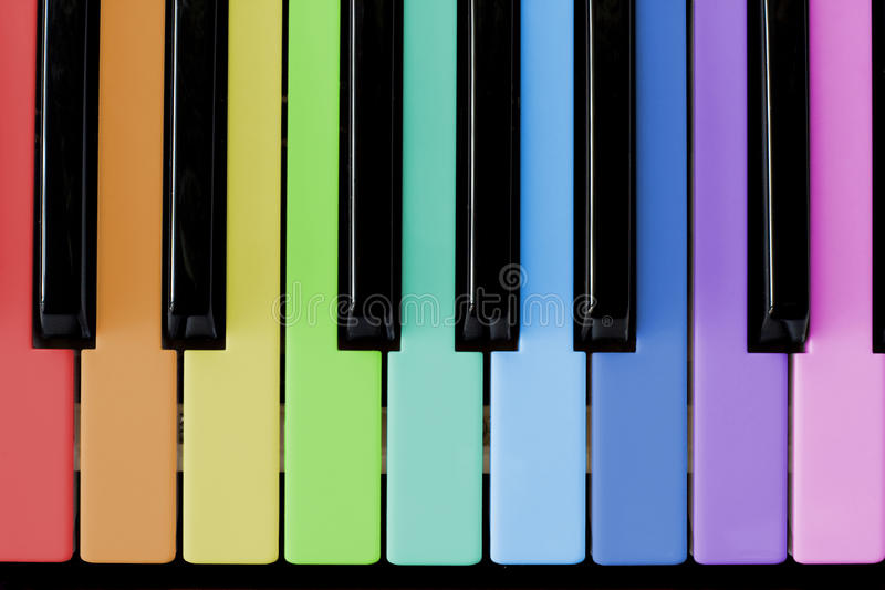 Piano. Black and multi-coloured keys of a piano royalty free stock photos