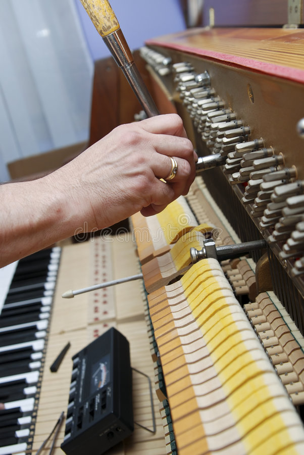 Piano ajustant 4 images libres de droits