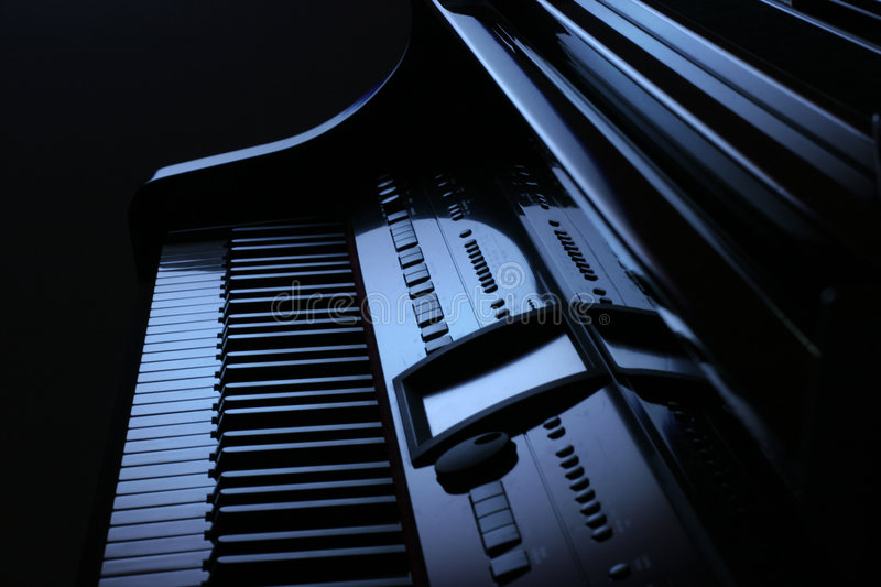 Piano in blue stock images
