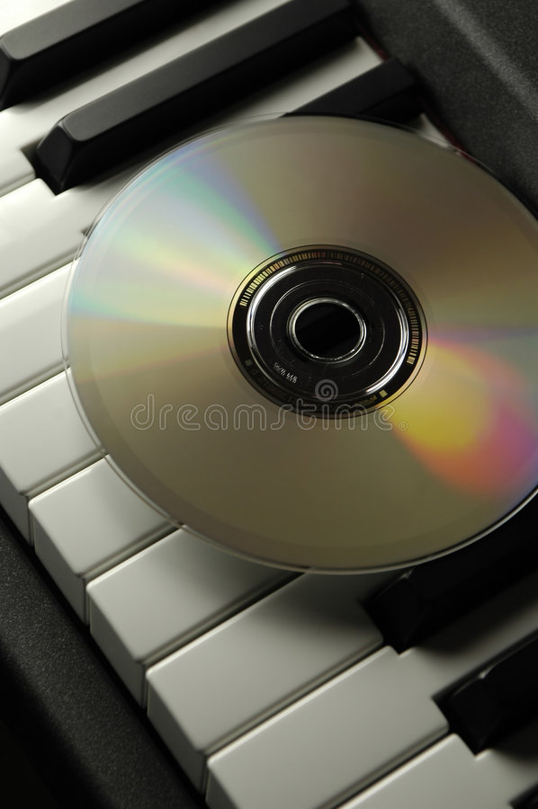 Download Piano And CD stock image. Image of color, formats, conflict - 1224125