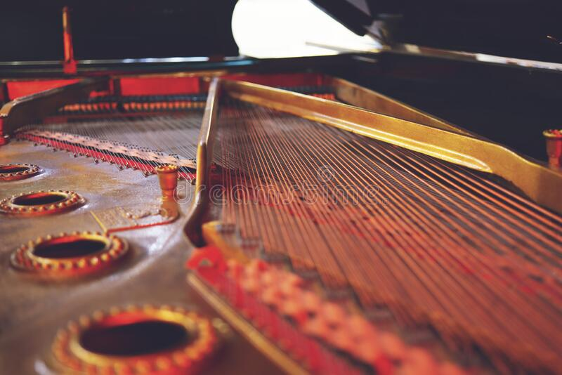 Piano close up. Grand piano detail Open inside music instrument stock photo