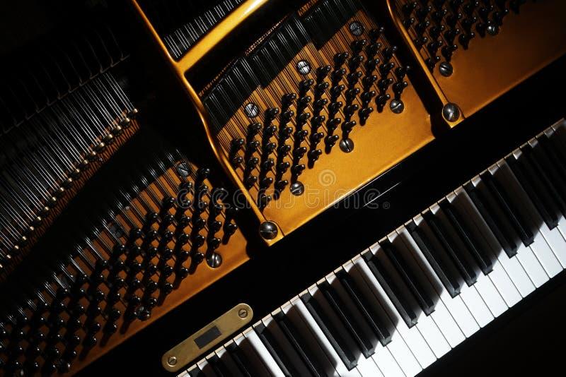 Piano close up. Grand piano keyboard closeup. Piano close up. Grand piano keyboard detail Open inside music instrument closeup royalty free stock photos