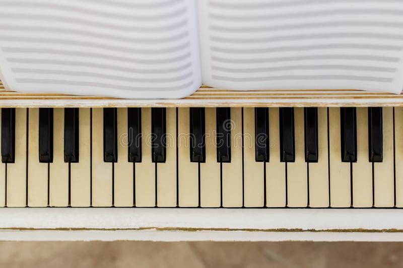 Piano close-up, musical instrument. learn to play the instrument. At home. white large piano. piano keyboard. concert concept royalty free stock image