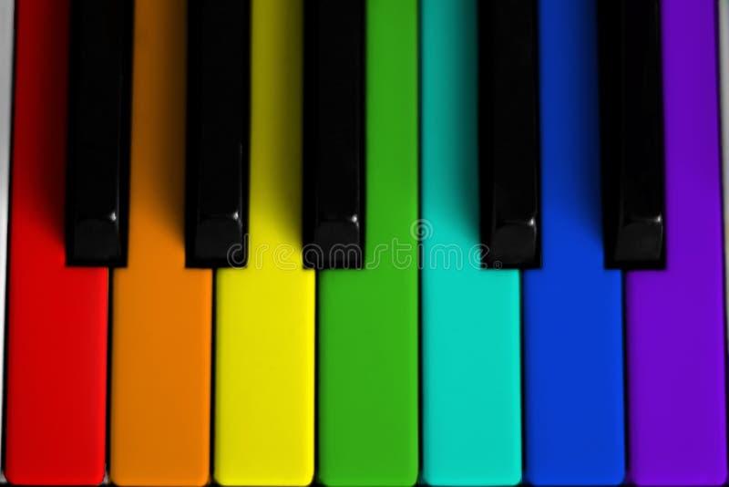 Piano colorido arco-íris imagem de stock
