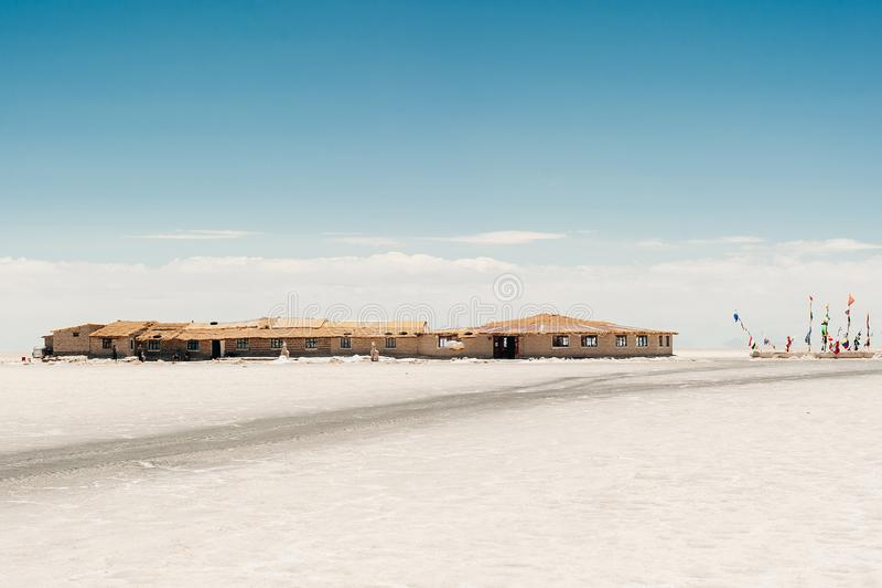 Piano del sale di Uyuni - Salar de Uyuni - casa fotografia stock libera da diritti