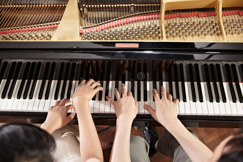 Piano duet royalty free stock images