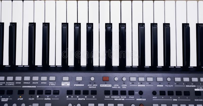 Piano or electronic synthesizer piano keyboard background Midi keyboard and controller with faders and buttons. Concept of close royalty free stock photos