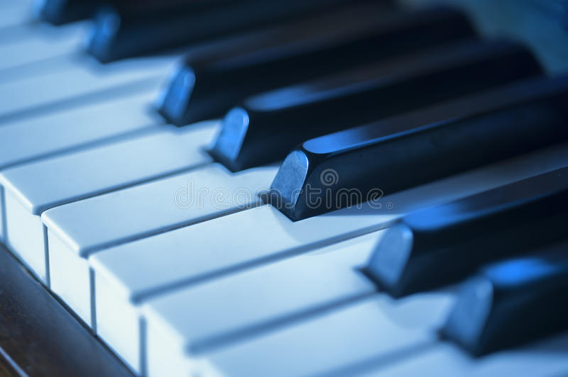 Piano key blues. Close-up of piano keys in blues as a concept for jazz royalty free stock photo