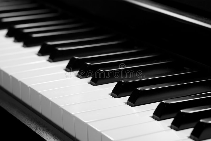 Piano keyboard. In Black and White, with High Contrast Lighting, evocative of the beauty of music stock photos