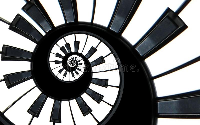 Piano keyboard abstract fractal spiral pattern background. Black and white piano keys round spiral. Spiral stair. Piano concept pa stock images