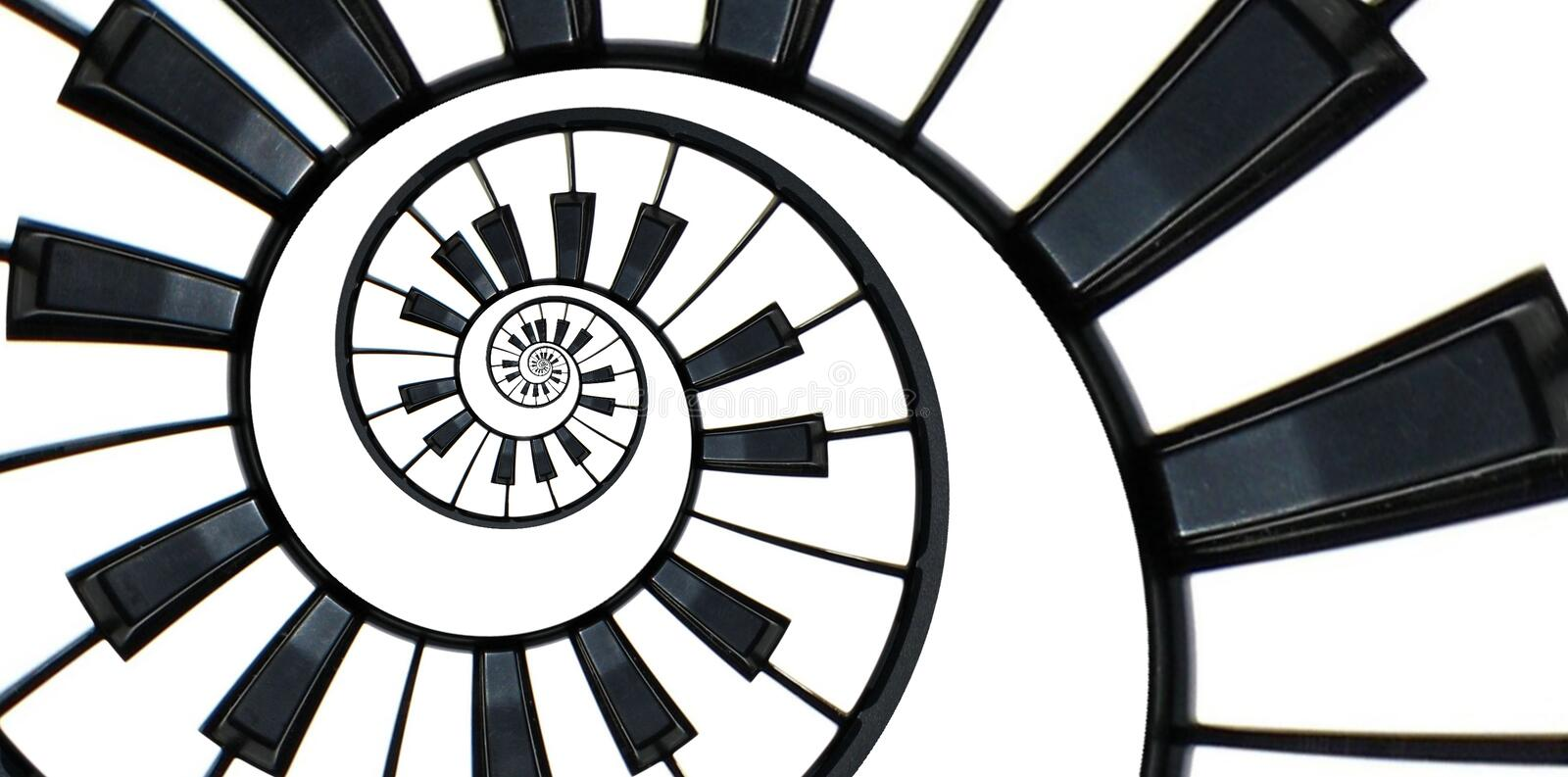 Piano keyboard abstract fractal spiral pattern background. Black and white piano keys round spiral. Spiral stair. Piano concept pa royalty free stock images
