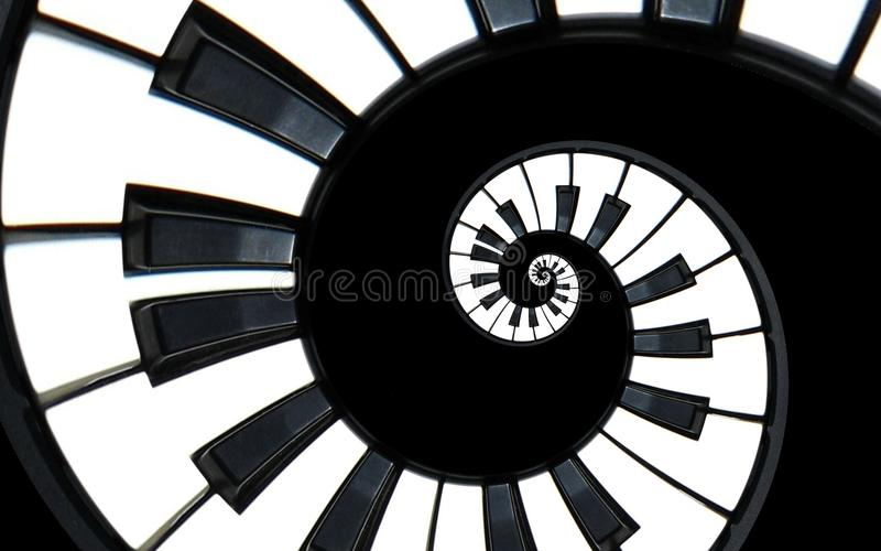 Piano keyboard abstract fractal spiral pattern background. Black and white piano keys round spiral. Spiral stair. Piano concept pa stock photos