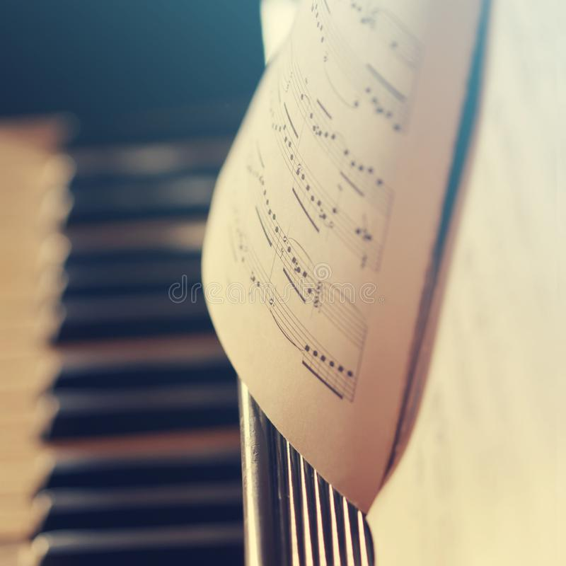 Piano keyboard background with selective focus. Warm color toned image royalty free stock photography