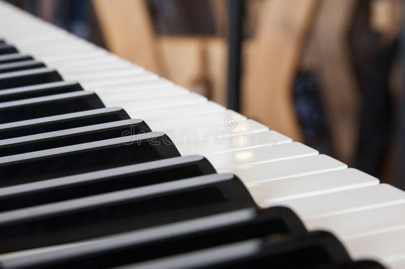 Piano keyboard closeup, blurry musical wallpaper like background. Home studio concept royalty free stock photos