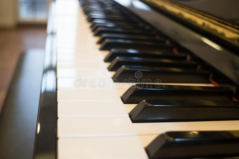 Piano keyboard colse up side view. Stock photo royalty free stock photo
