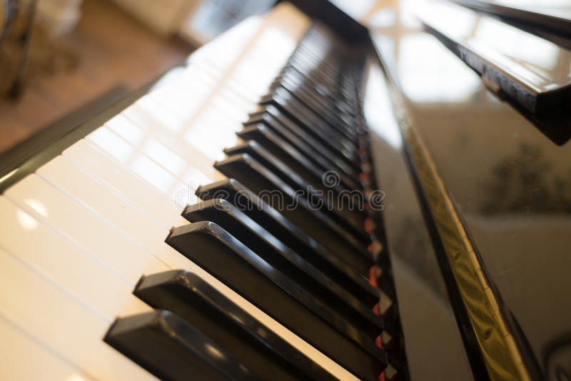 Piano keyboard colse up side view. Stock photo royalty free stock images