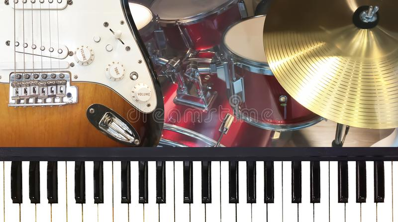Piano keyboard electric guitar and golden cymbal music instrume royalty free stock image