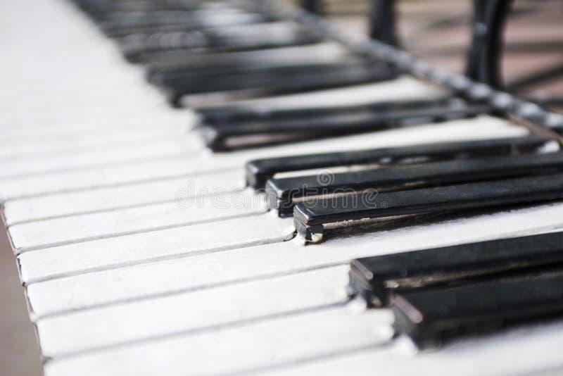 Piano keyboard. Grand piano keys closeup. Classical music instrument. Metal construction, monument.  stock photos