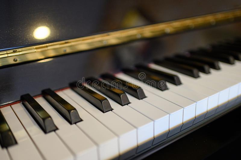 Piano keyboard instrument with shining background. selective focus royalty free stock images