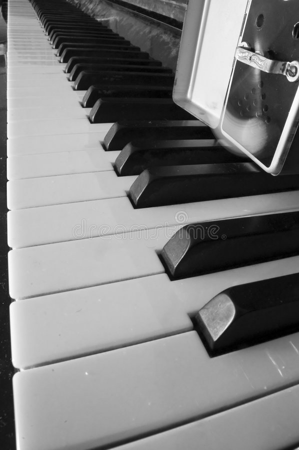 Piano keyboard and metronome royalty free stock images