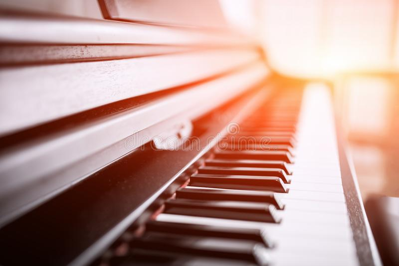 Piano, keyboard piano, side view of instrument musical tool. royalty free stock image