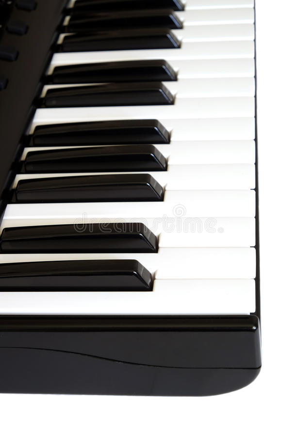 Piano keyboard with white and black keys on white background royalty free stock photography