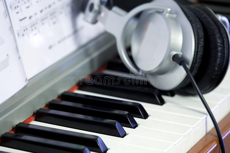Piano keys and Headphones. For background royalty free stock photo