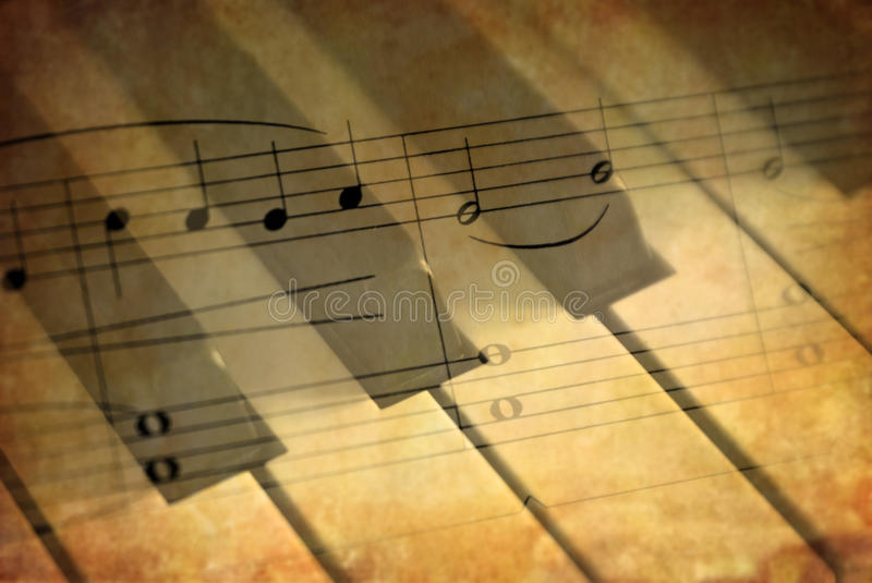 Piano keys with music stock photo