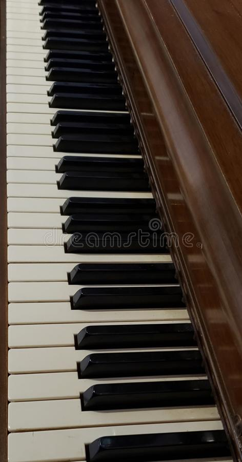 Piano Keys Vertical View. Of piano keys  pianokeys music keyboard ebony ivory long vertical stock photos