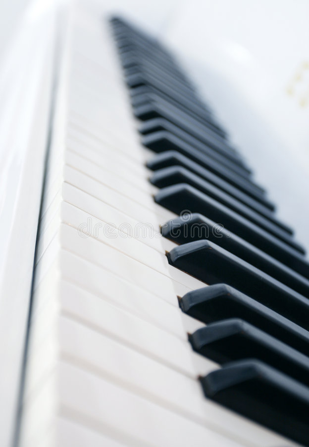 Piano keys side view royalty free stock images