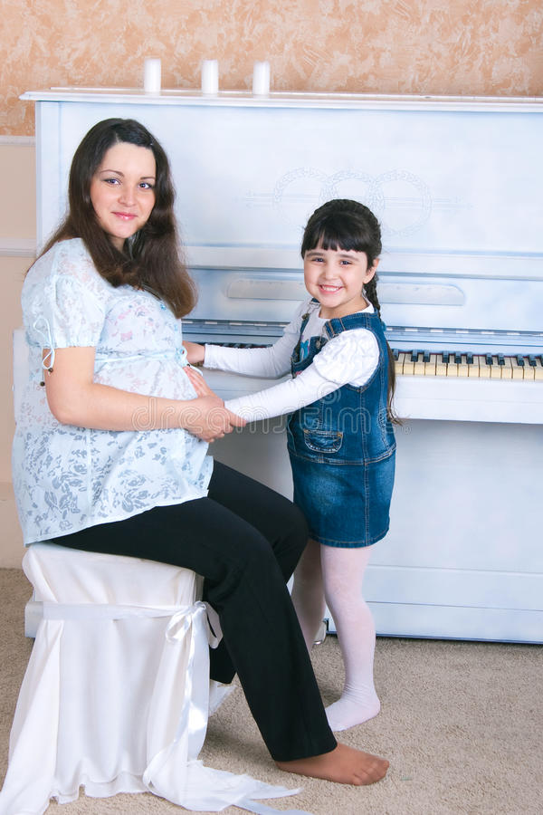 Piano Lessons - Mother and Daughter royalty free stock photography