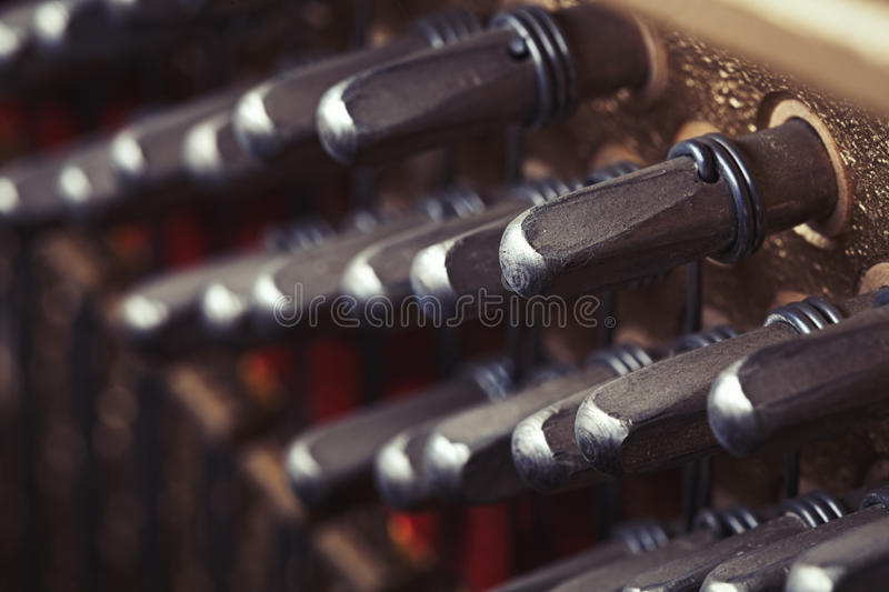 Piano maintenance - staying in tune royalty free stock photo