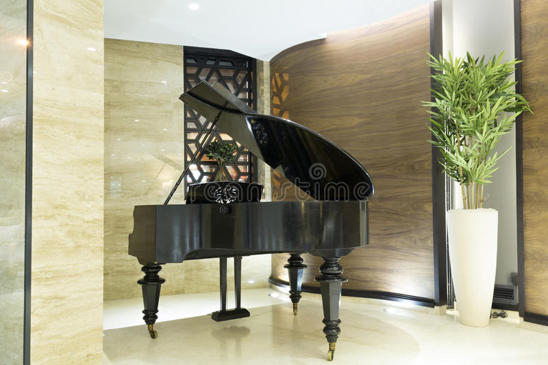 Piano in modern hotel lobby stock photography