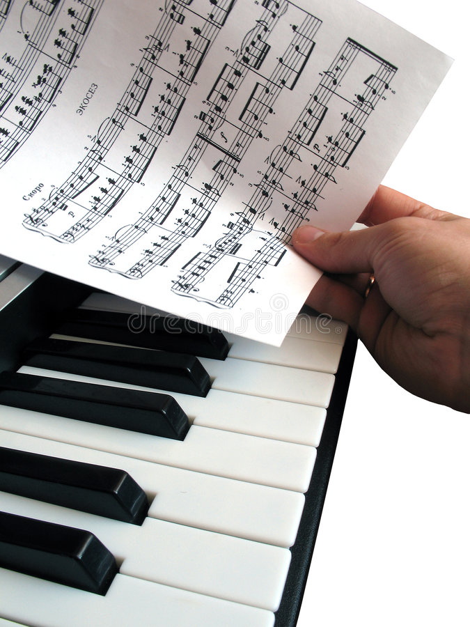 Piano music with hand isolated. Piano music with hand, isolated, musical instrument, synthesizer, loves song stock photo