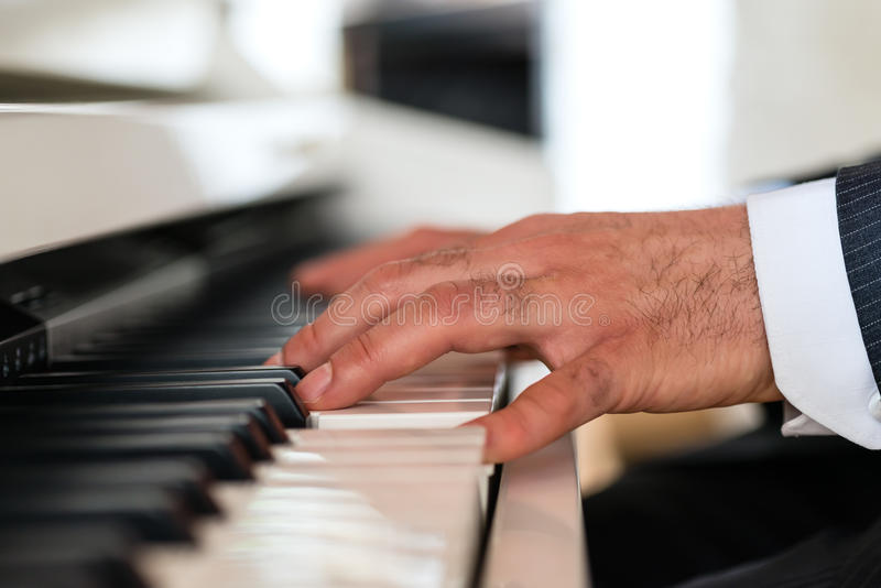Piano player in a fine restaurant royalty free stock image