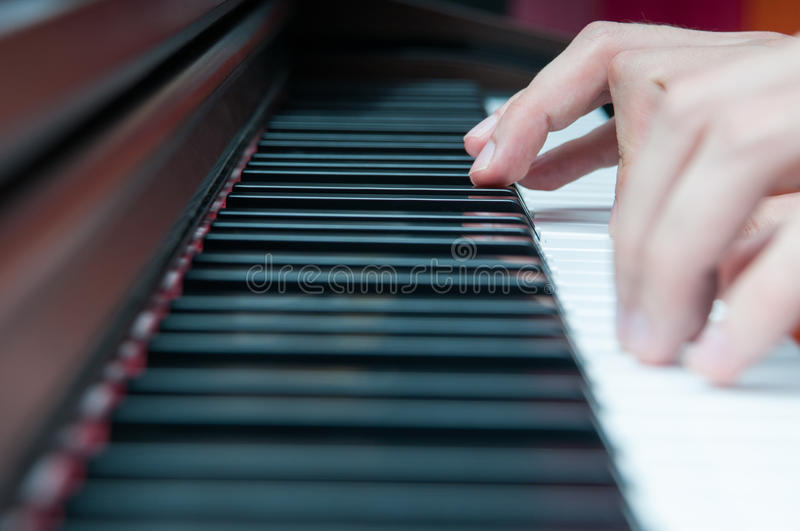Piano player. Hands in close up view royalty free stock photo