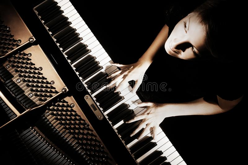 Piano player. Pianist playing grand piano concert. Musical instruments royalty free stock image