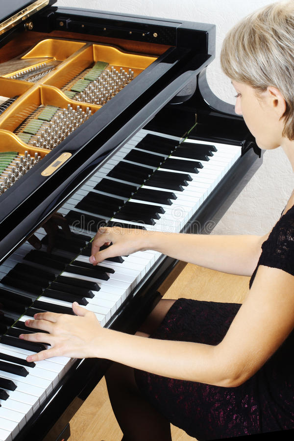 Piano Playing Pianist Player. Royalty Free Stock Image